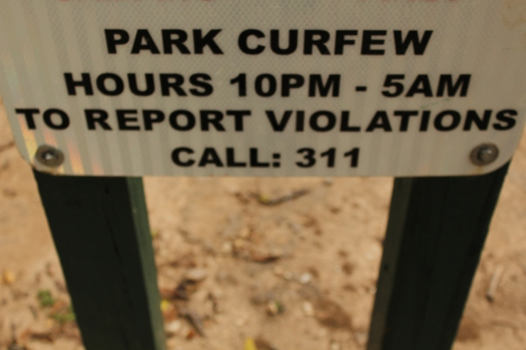 This sign is one of the many posted around Zilker Park to deter people from using the park after hours. Photo by: Lauren Keim